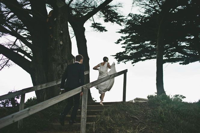 Bride groom walking up stairs in Lorne