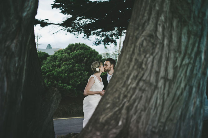 Bride groom kissing tree Lorne Melbourne