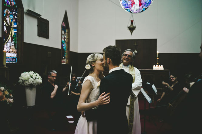 Bride groom kissing in church Lorne