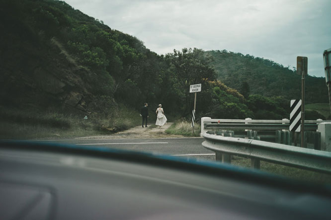 Bride and groom next to road in Lorne Melbourne