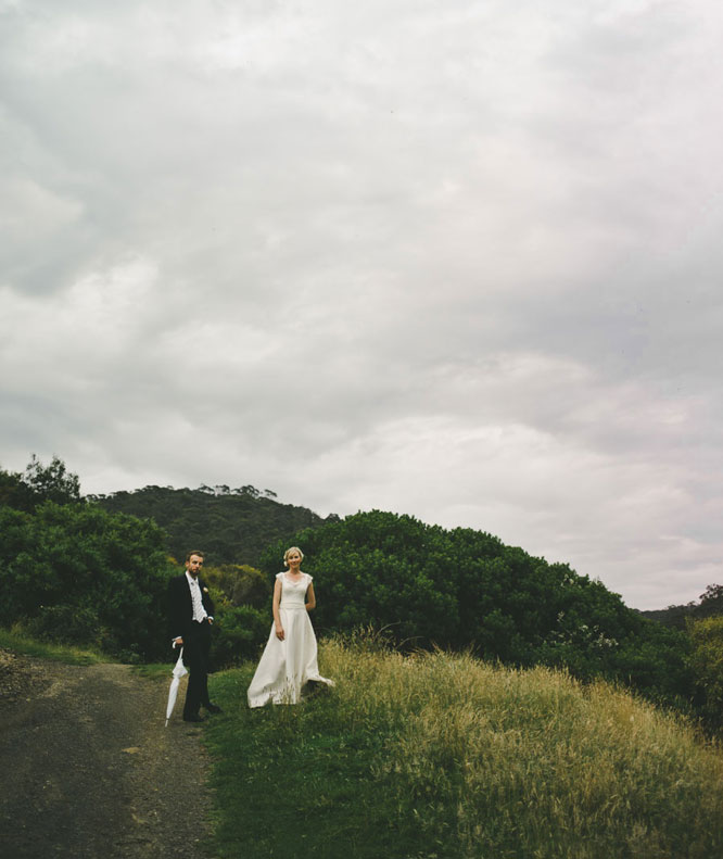Bride and groom with umbrella in Lorne