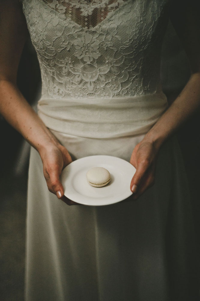 Bride with white macaron in Lorne wedding