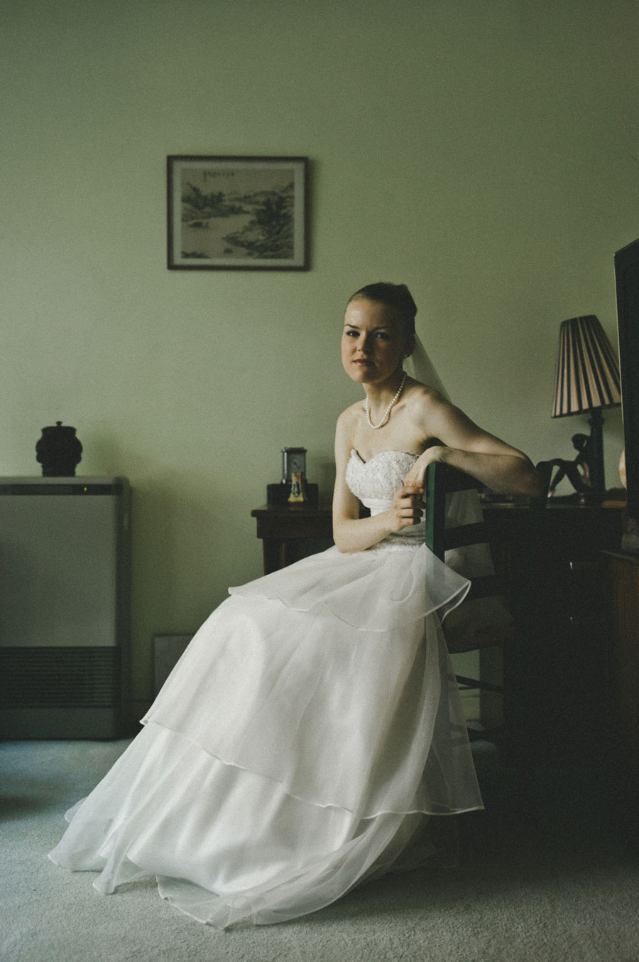 Bride sitting in the living room