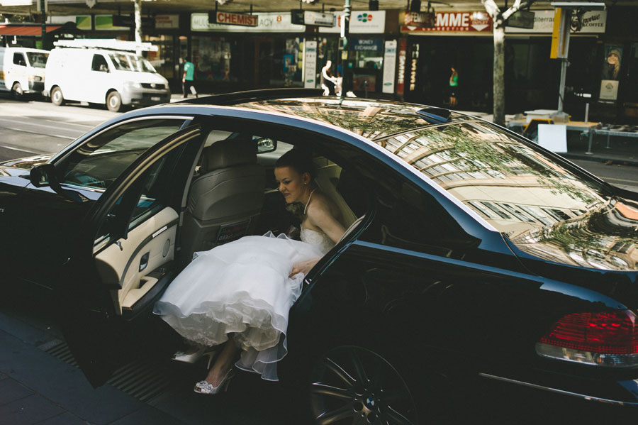 Bride getting out of car in Melbourne CBD