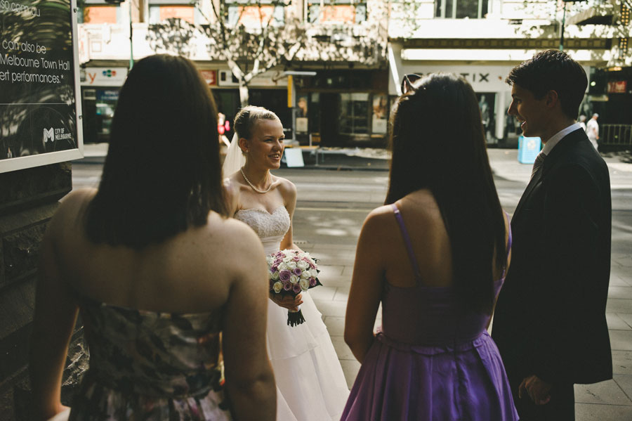 Bride greeting friends in front of Melbourne city hall