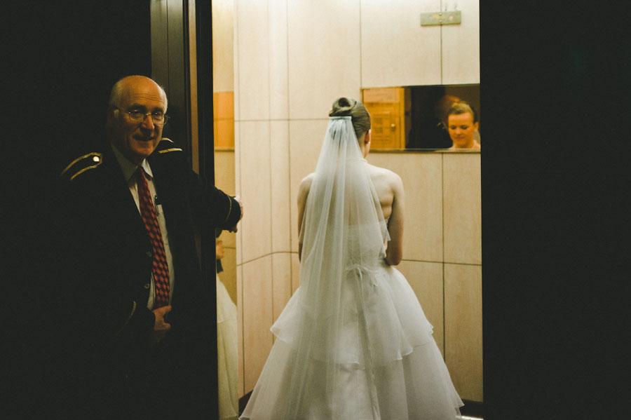 Bride entering Melbourne city hall elevator