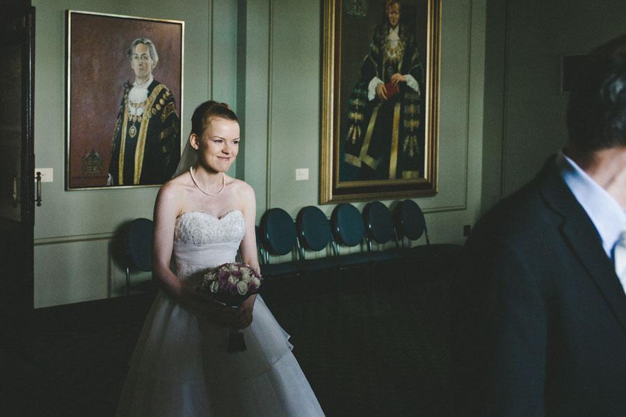 Bride entering Melbourne city hall balcony