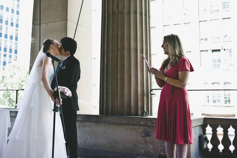 Bride and groom kisses