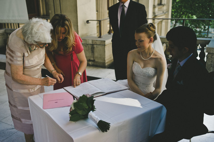 Witness signing during wedding ceremony at Melbourne city hall