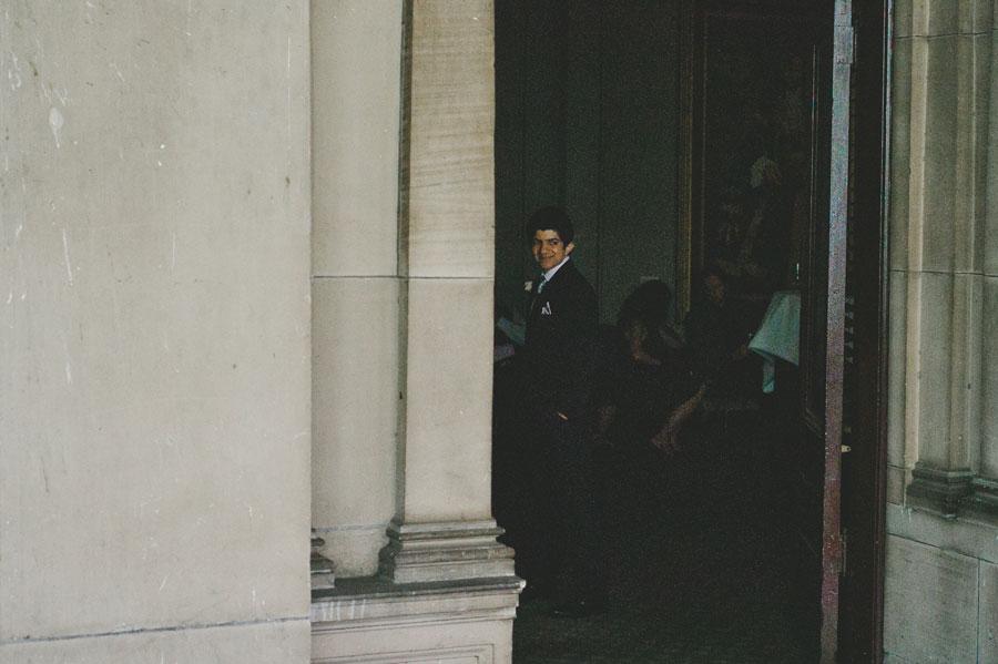 Groom smiling inside Melbourne city hall