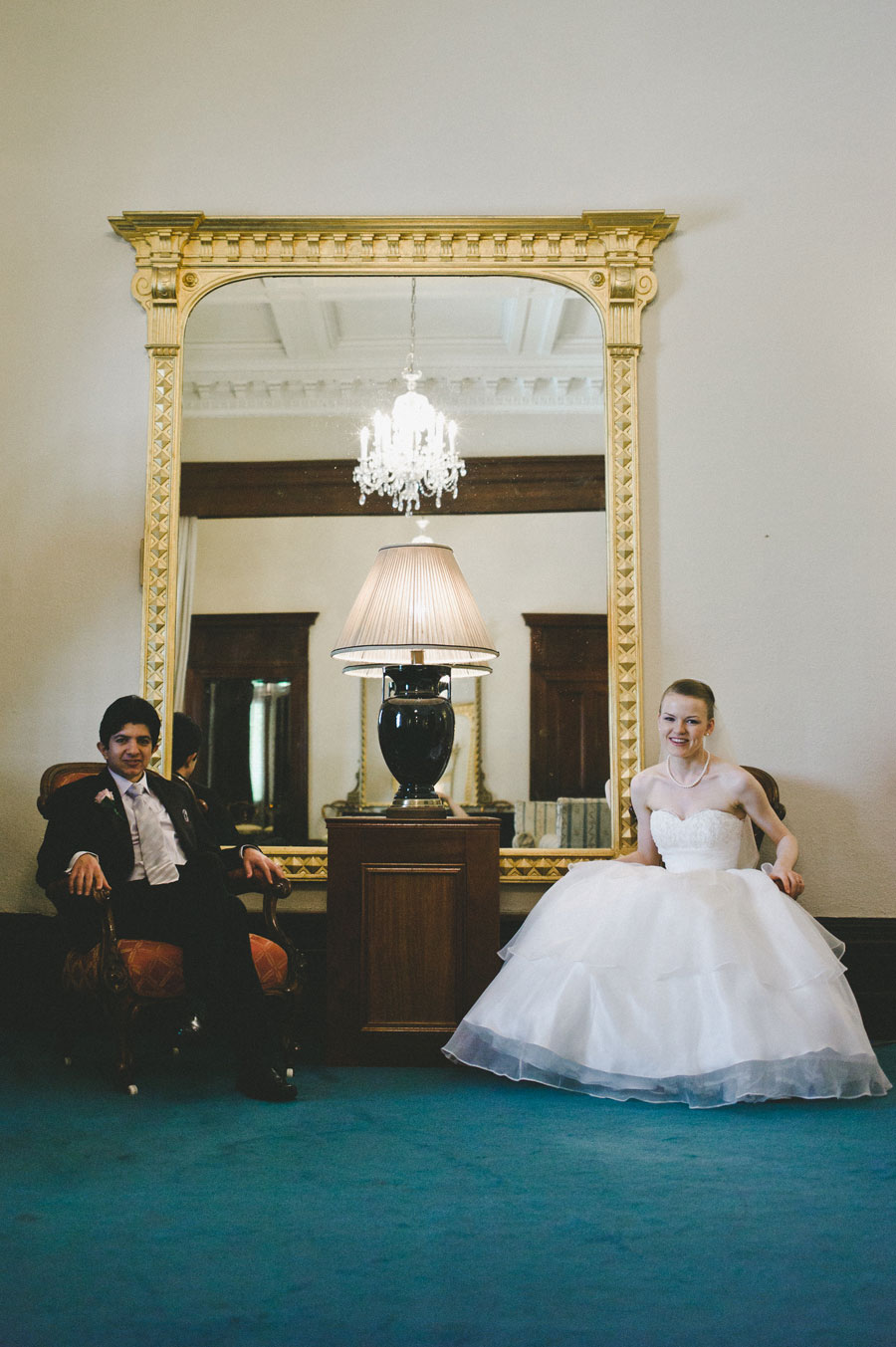 Bride and groom sitting in Melbourne city hall