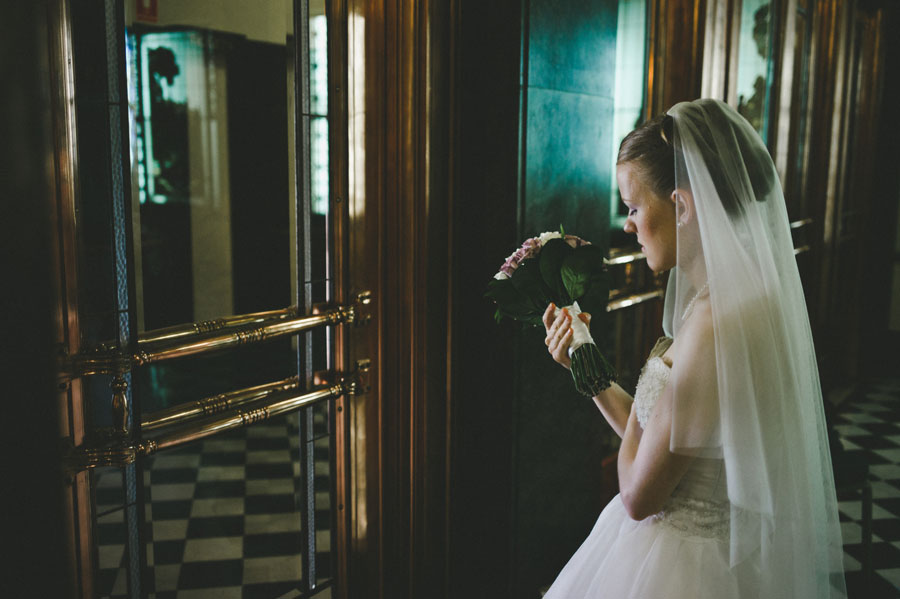Bride waiting for wedding car at Melbourne city hall