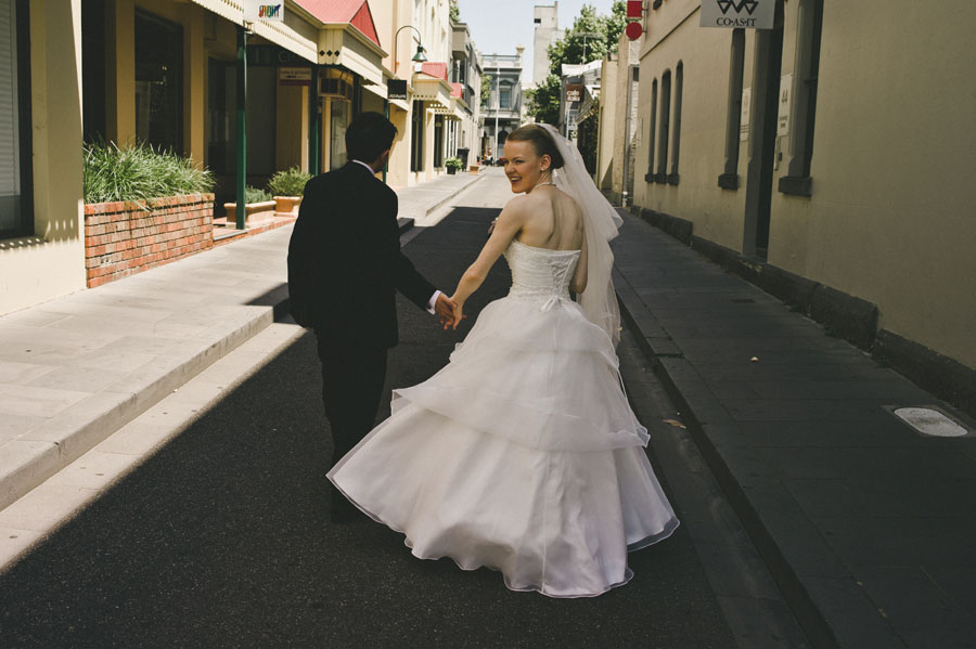 Bride and groom walking to reception at Lygon