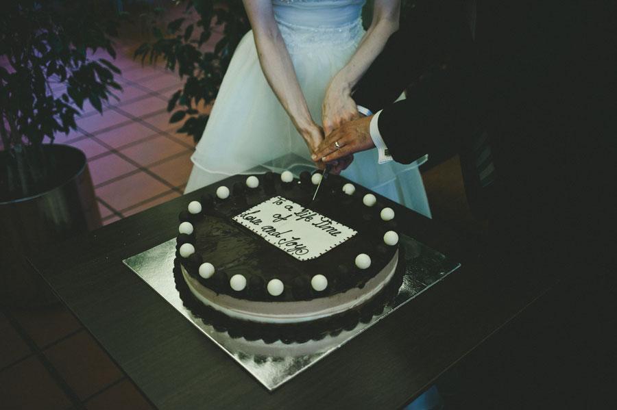 Bride and groom slicing wedding cake at Bar Italia Melbourne