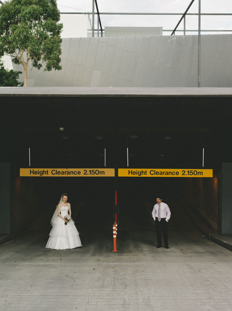 Bride and groom outside carpark of Melbourne Museum