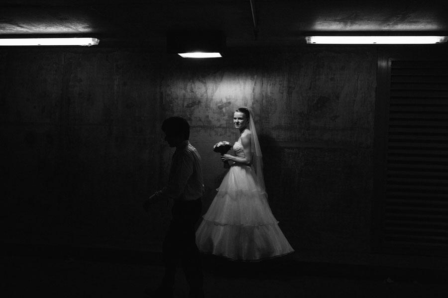 Bride walking underneath carpark of Melbourne Museum