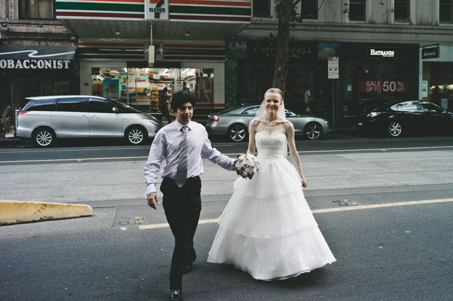 Wedding couple crossing the road in Melbourne CBD