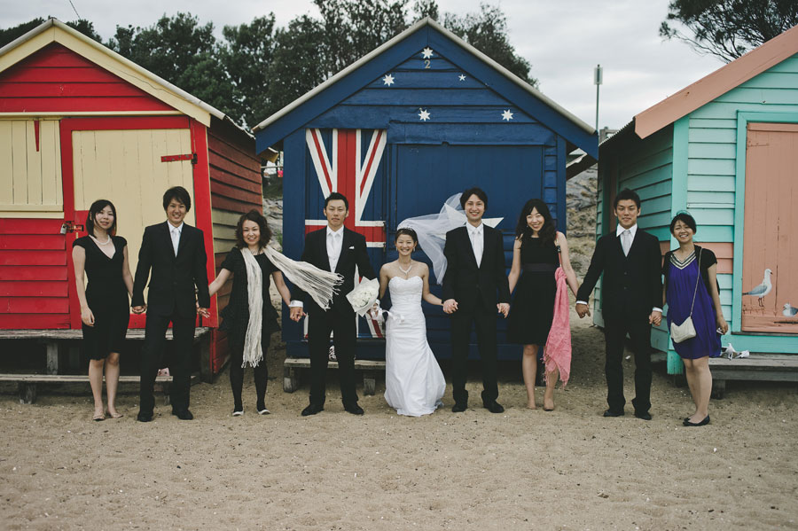Wedding group in front of Brighton cottages