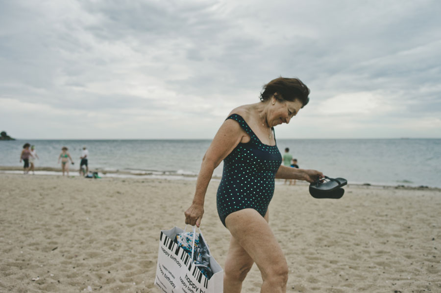 Lady in bathing suit at Brighton beach