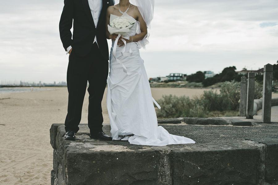 Lower body of wedding couple at Brighton Beach