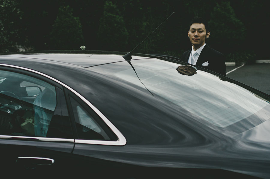 Groom getting into car for wedding in Melbourne
