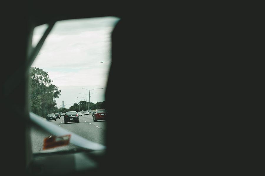 Trailing behind the wedding car