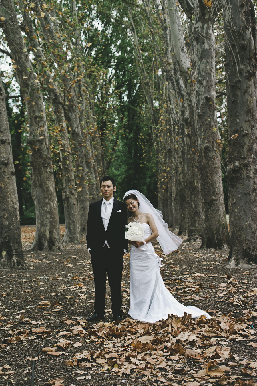Bride leaning on groom at Fitzroy Garden