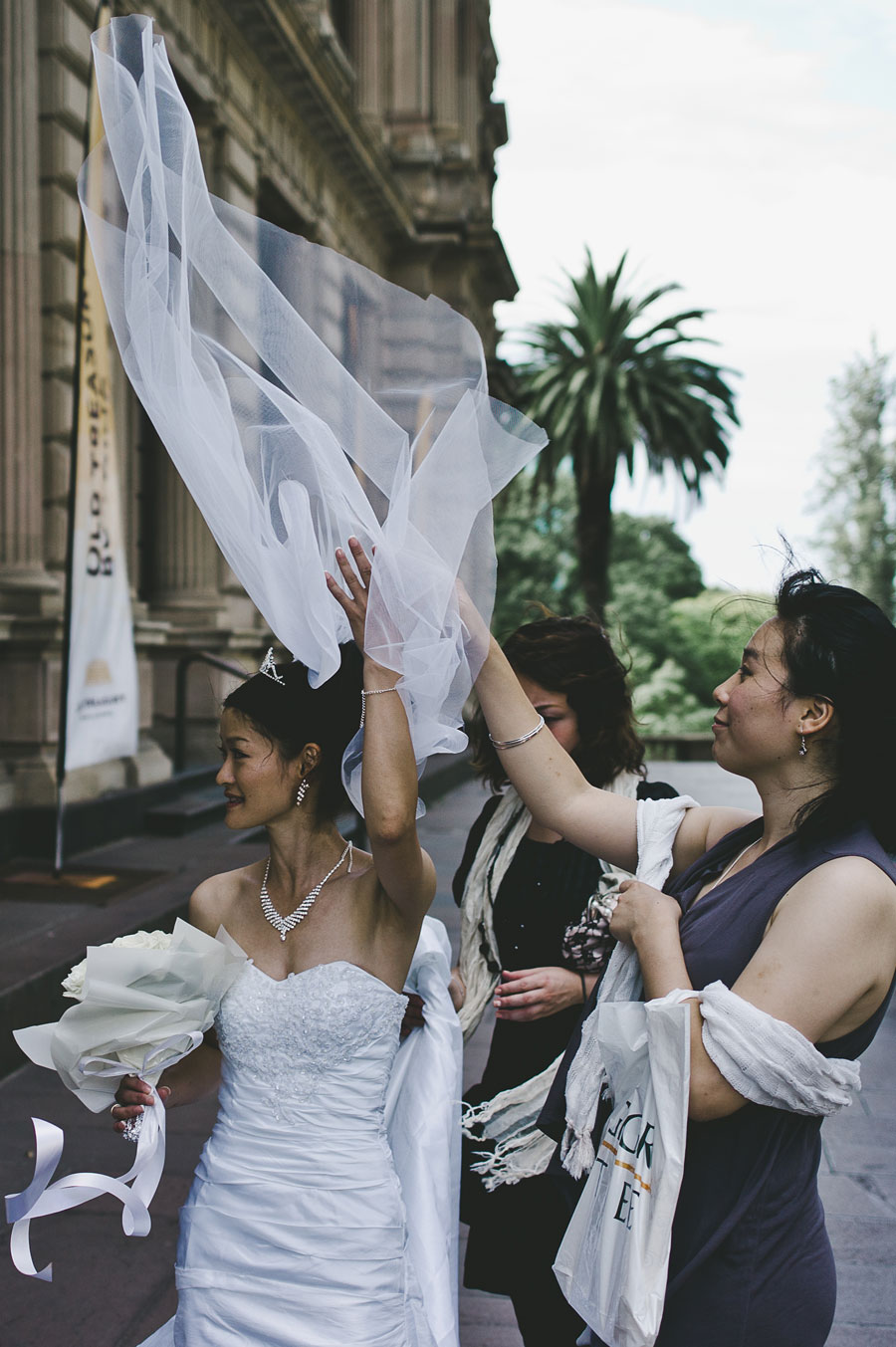 Windy wedding day outside Old Treasury Building