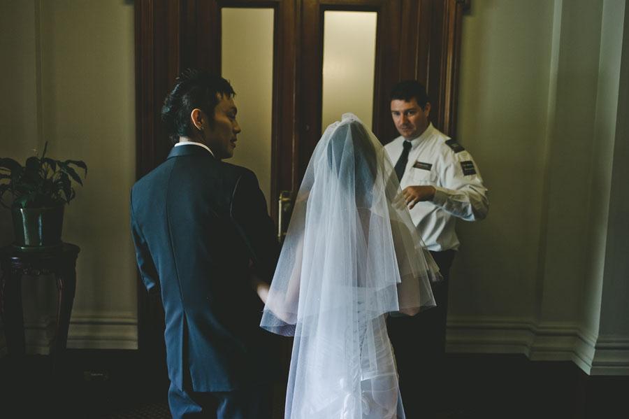 Japanese bride and groom entering Old Treasury Building