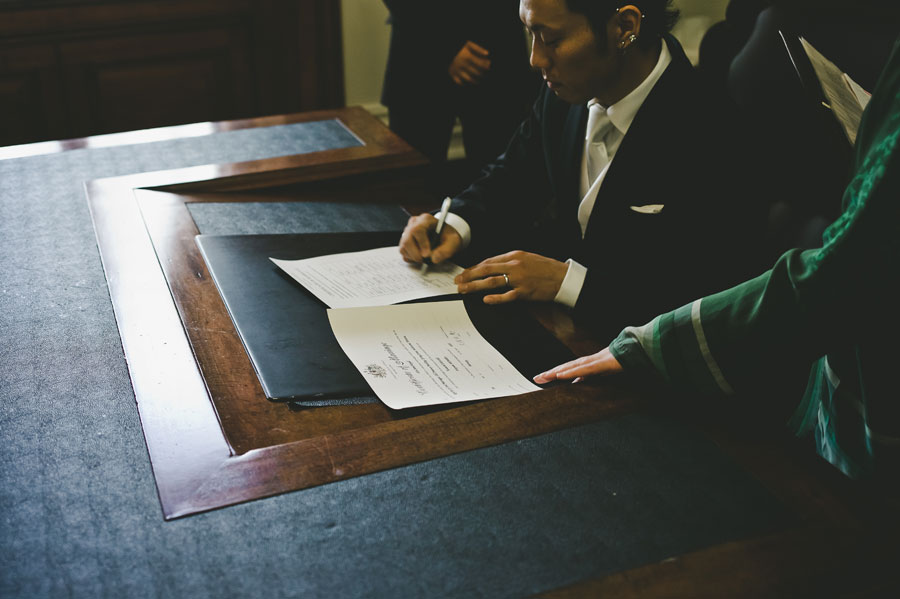 Groom signing wedding certificate in Melbourne