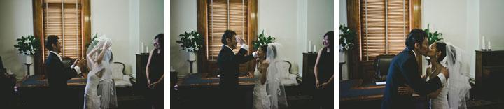 Japanese groom kissing bride in Melbourne wedding ceremony
