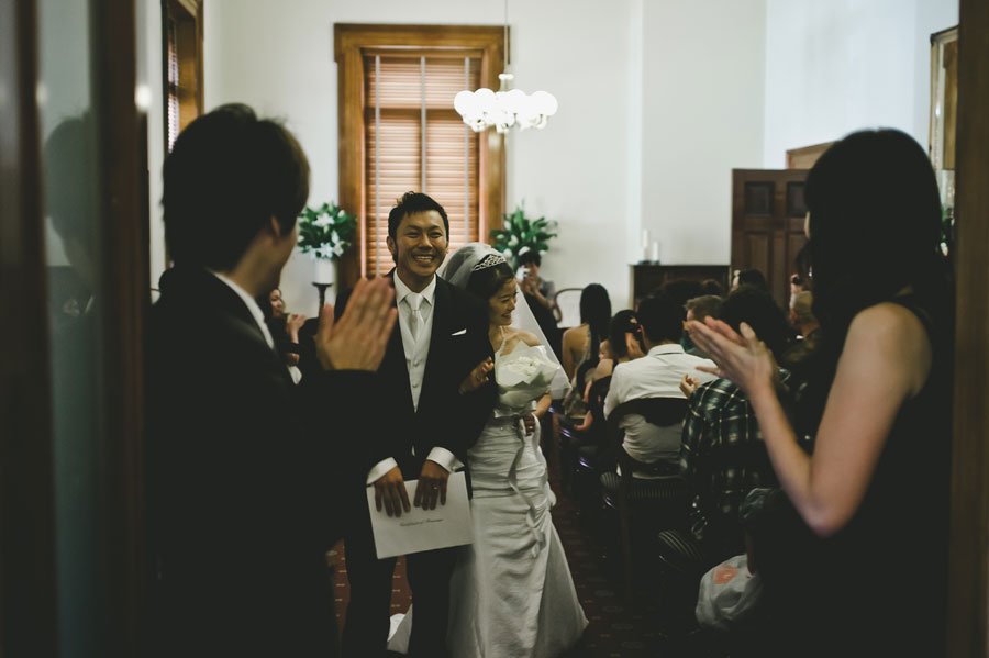 Japanese bride and groom exits Old Treasury Building