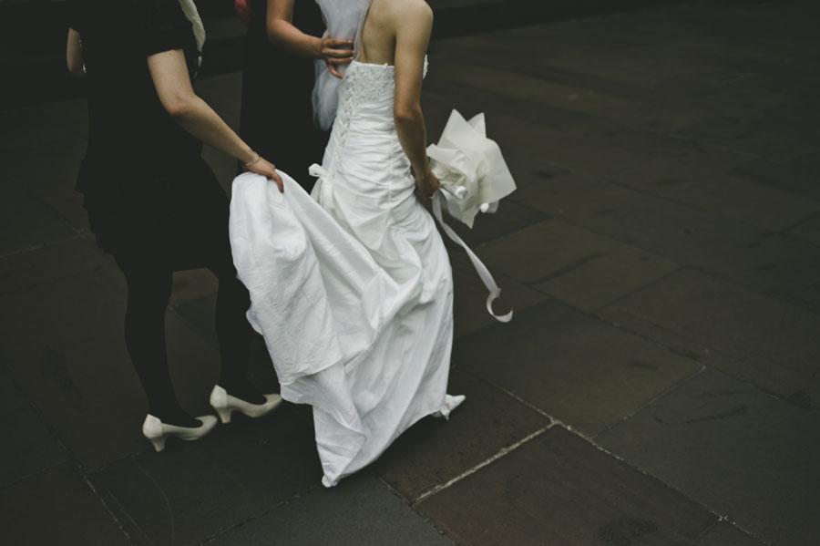 Girl holding Japanese bride's dress after Melbourne wedding ceremony