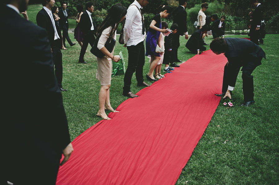 Guests standing on wedding red carpet in Treasury Garden