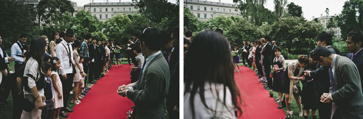 Wedding guests on both side of red carpet Treasury Garden