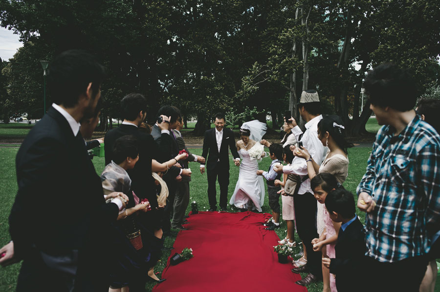 Wedding couple in front of red carpet Treasury Garden