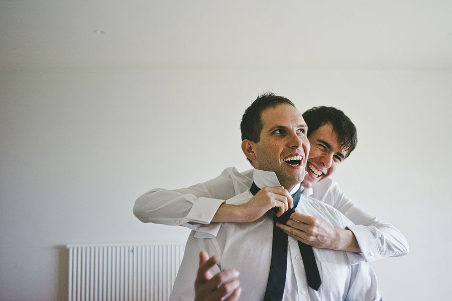 Groom helping best man with tie - Pheonix apartments Lorne