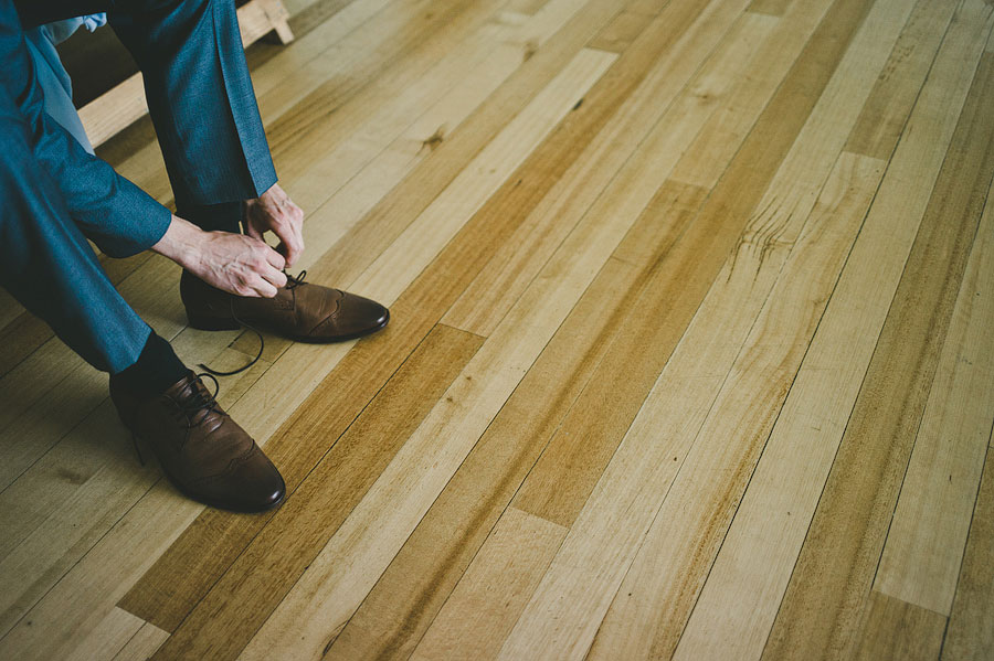 Groom with his leather shoes in Pheonix apartments at Lorne