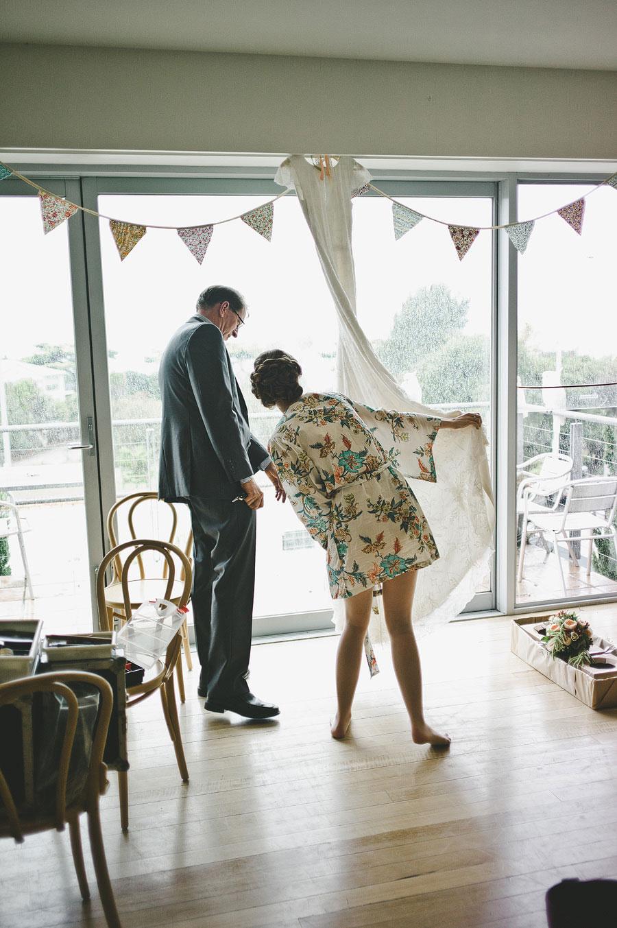 Pheonix apartments, Lorne - bride checking wedding dress