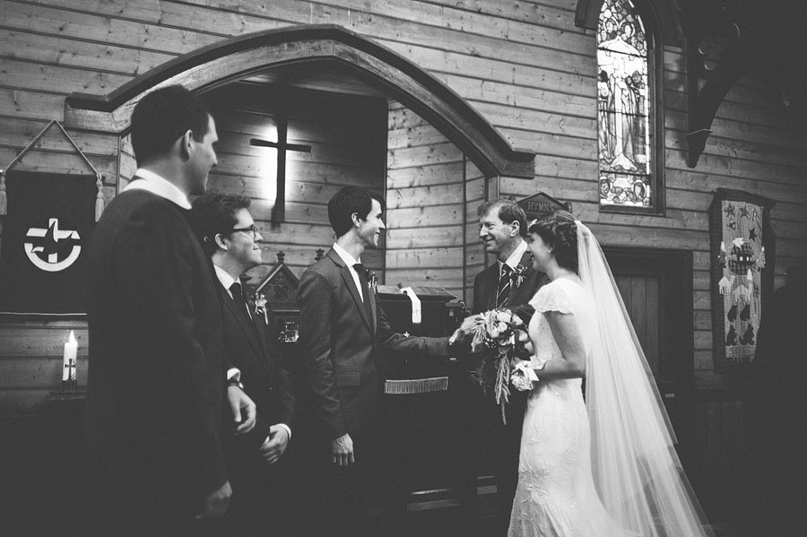 St Cuthberts Church, Lorne - groom takes the bride's hand