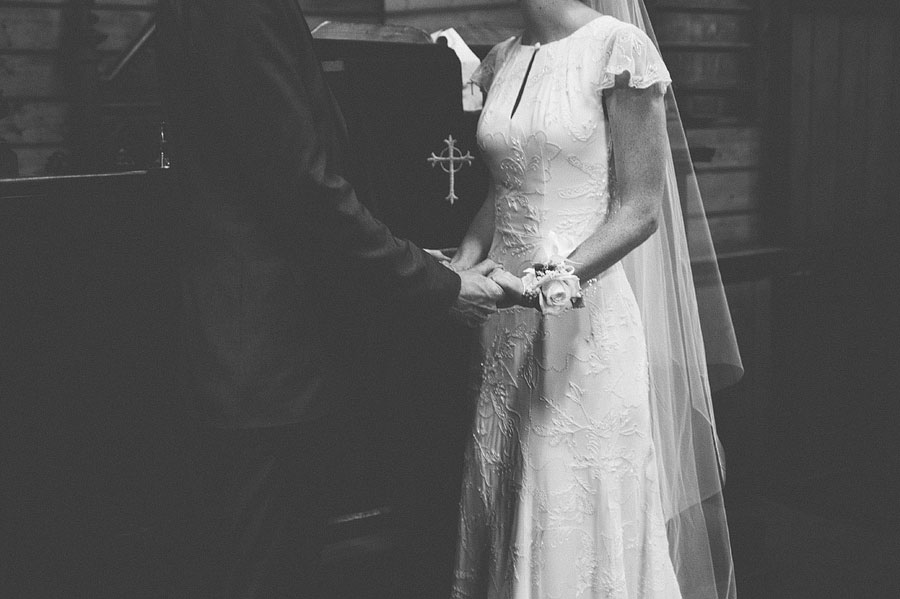 St Cuthberts Church, Lorne - wedding bride and groom holding hands