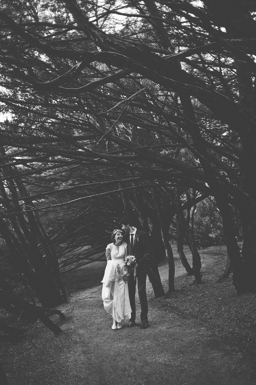 Bride and groom embrace in the woods at Lorne, Melbourne