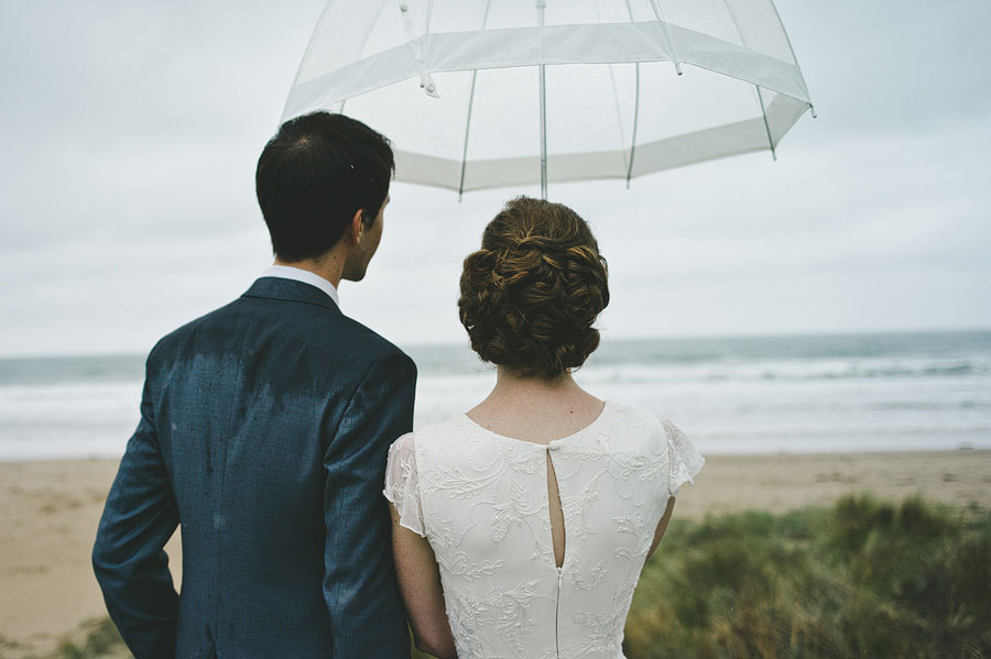 Bride and groom looking at the Lorne ocean