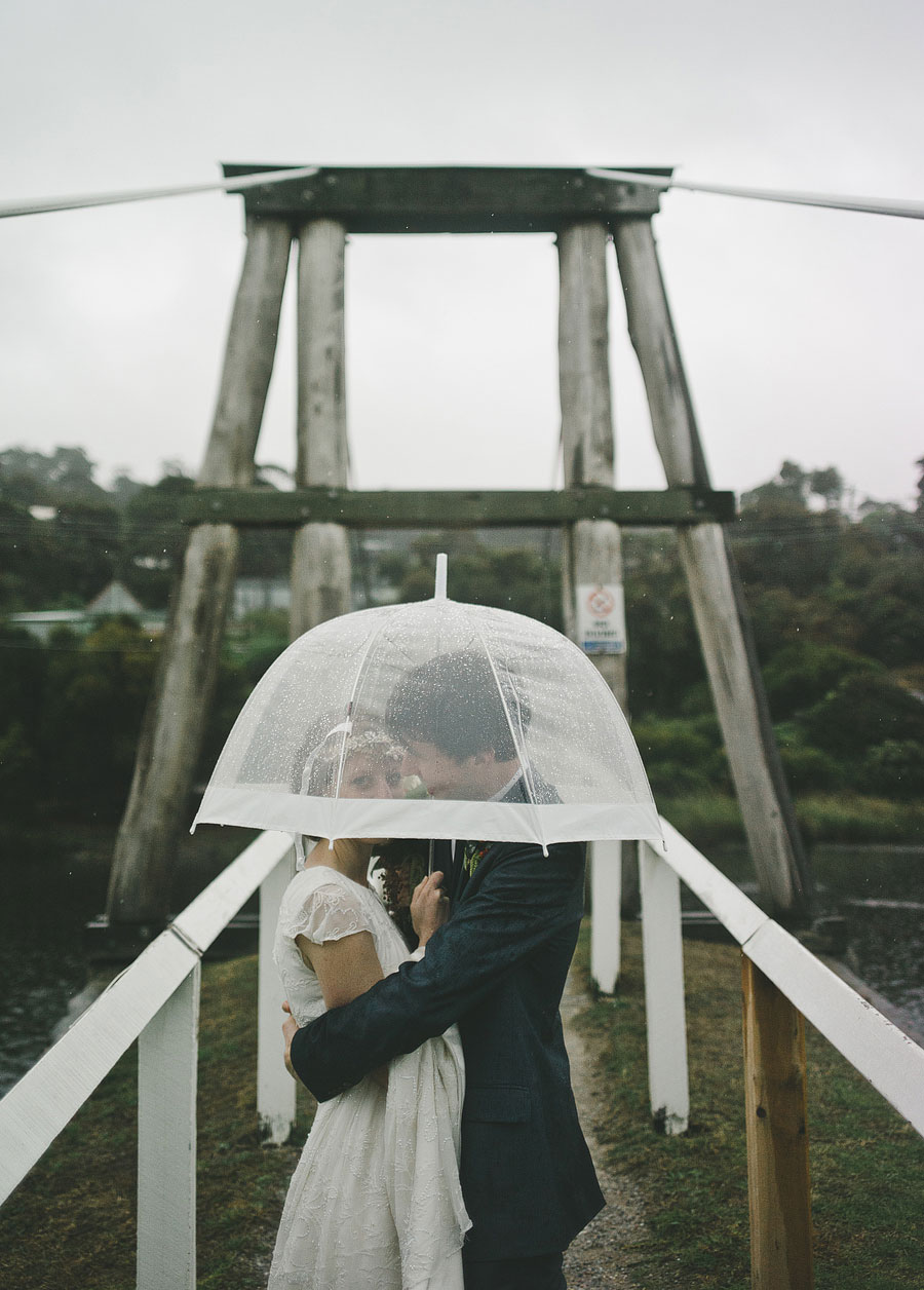 Couple under umbrella - Lorne hang bridge - wedding photographer