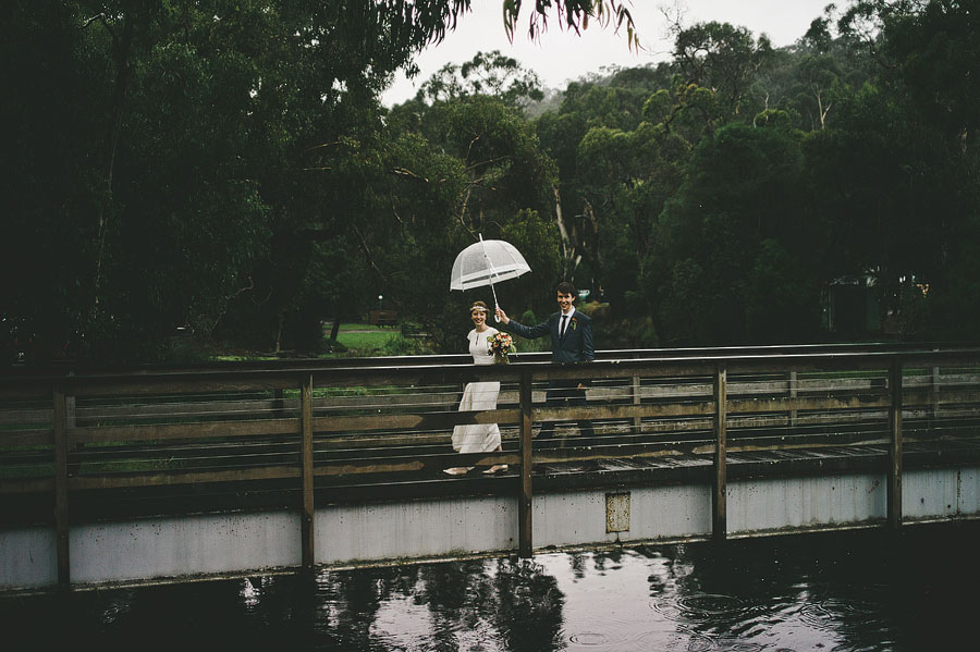 Wedding couple passing the bridge before reception at Lorne