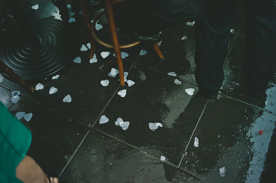 Paper hearts on wet floor, Babalu bar - Lorne