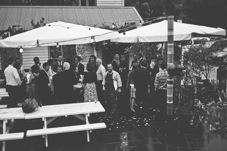 Wedding guests chatting at Babalu bar - Lorne