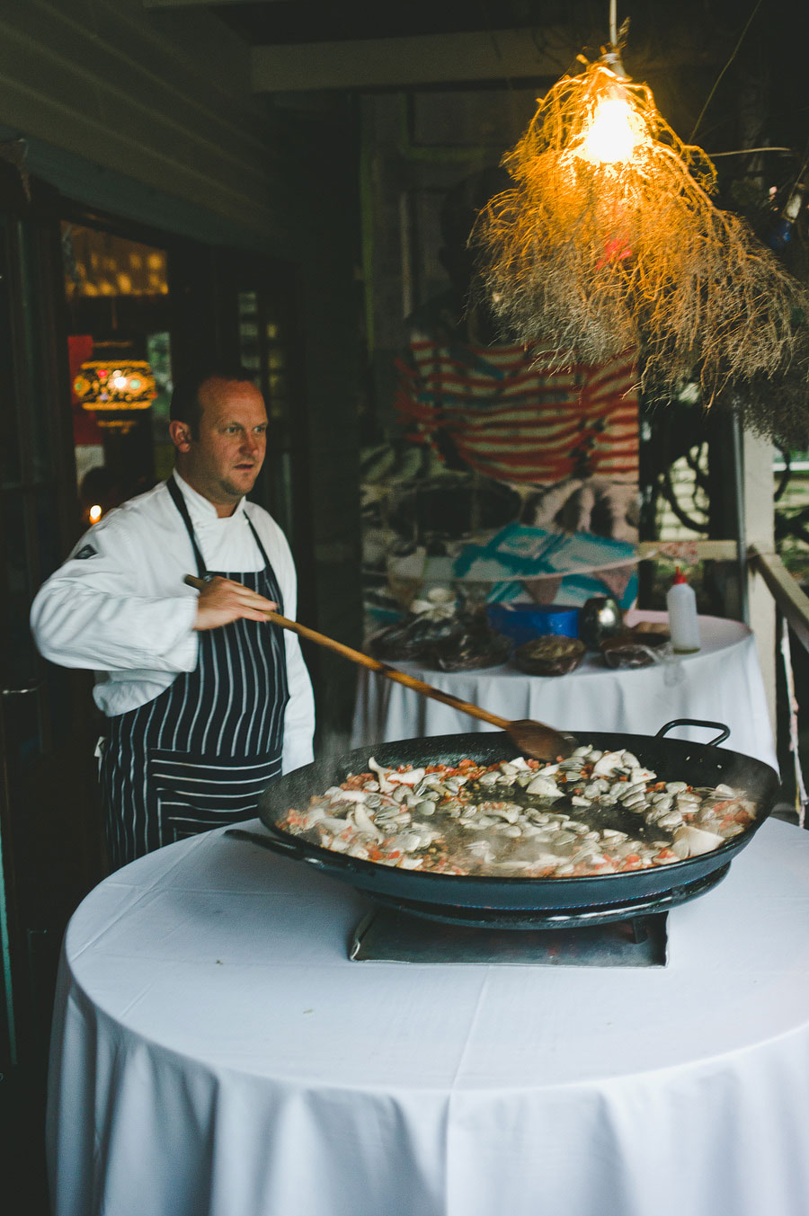 Chef cooking paella at Babalu bar - Lorne wedding