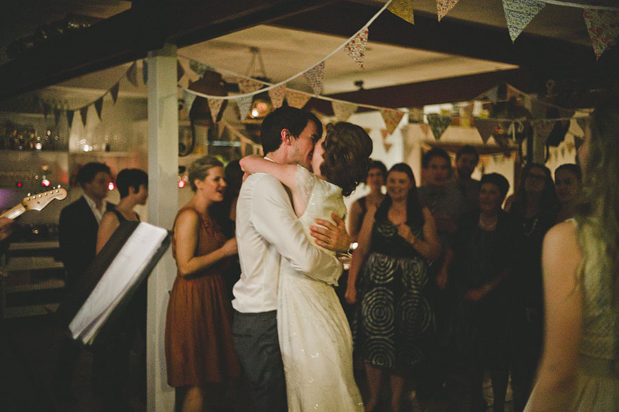 Bride and groom kissing on dancefloor - Babalu bar - Lorne