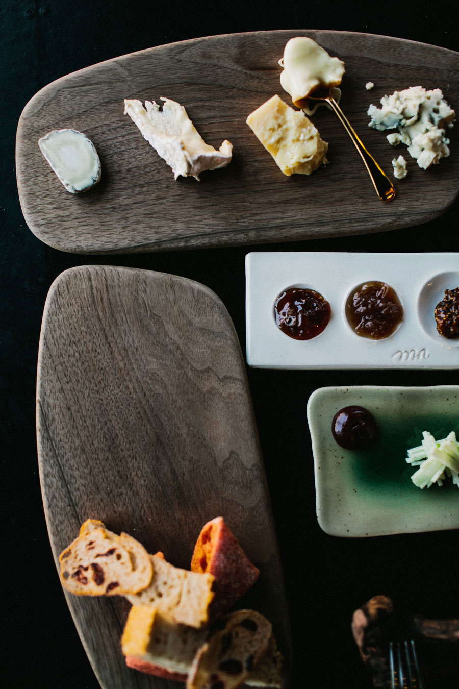 Assorted cheese, bread, and jam at Vue De Monde Melbourne